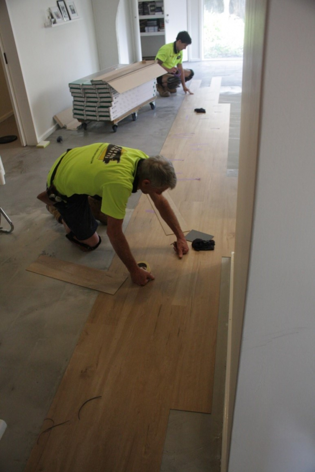 Laying tile over vinyl flooring